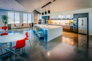Modern and functional breakroom at Akamai, managed by FaciliCorp