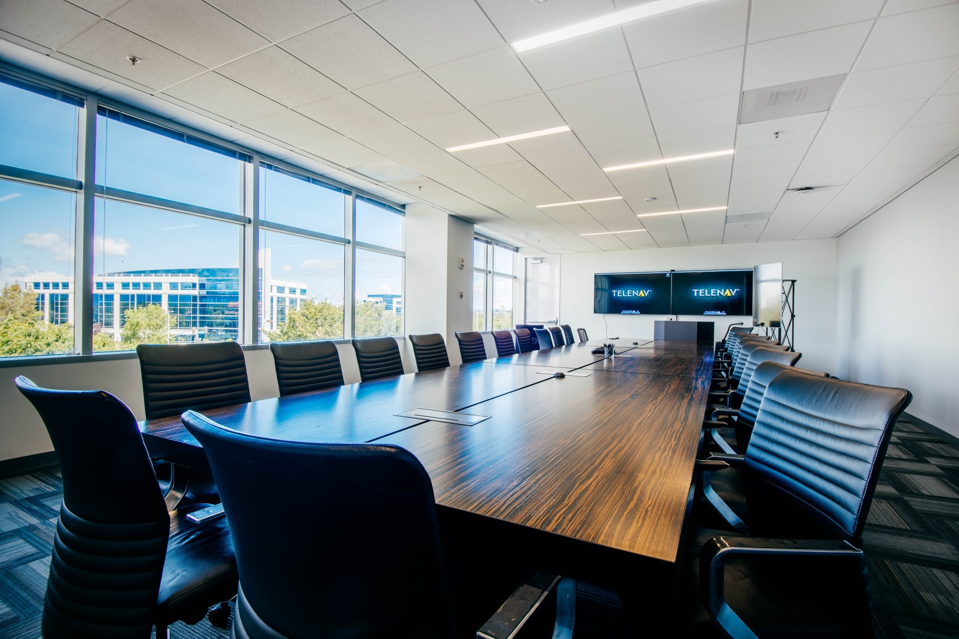 FaciliCorp manages design and construction of modern board room for Telenav in Silicon Valley